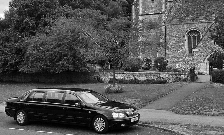 Mead Family Funerals limousine outside a church-min