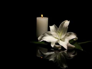 lit candle and flower